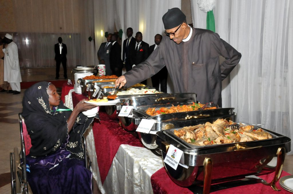 PIC  20. PRESIDENET MUHAMMADU BUHARI (R) SERVING  FOOD TO  A PHYSICALLY CHALLENGED PERSON, MISS  RAHINA KARMAJIJI, DURING BREAKING OF RAMADAN FAST WITH INTERNALLY DISPLACED PERSONS (IDPs),   ARTISANS AND OTHER NIGERIANS AT THE PRESIDENTIAL VILLA ABUJA ON MONDAY (4/7/16) 4821/04/07/16/ICE/NAN
