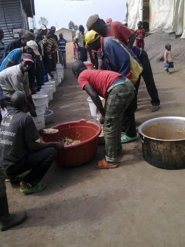 This is how the EX-FDLR are cooking in Kisangani Camp. A group of 55 persons cook one time til all the 1000 finish, it is late at night