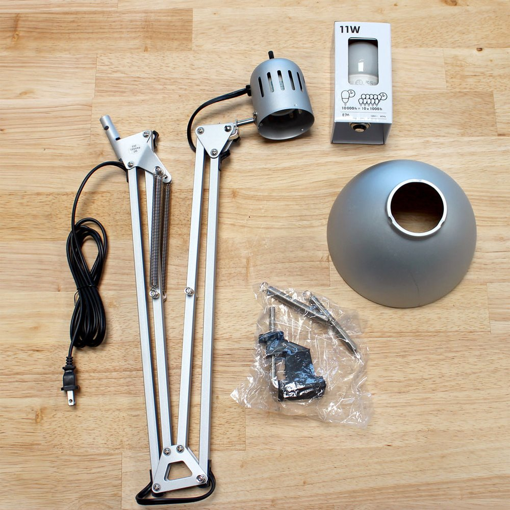 For this project we only need the articulating arm of the lamp. This IKEA  lamp only had two small bolts attaching the lamp head to the arm, after  removing ...