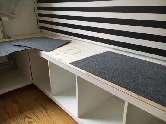 Glue felt tiles onto shelves