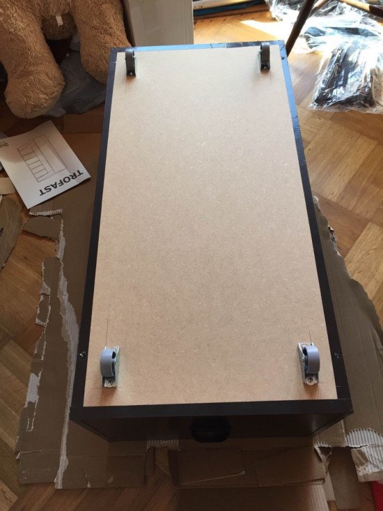 Add casters to make a rolling drawer