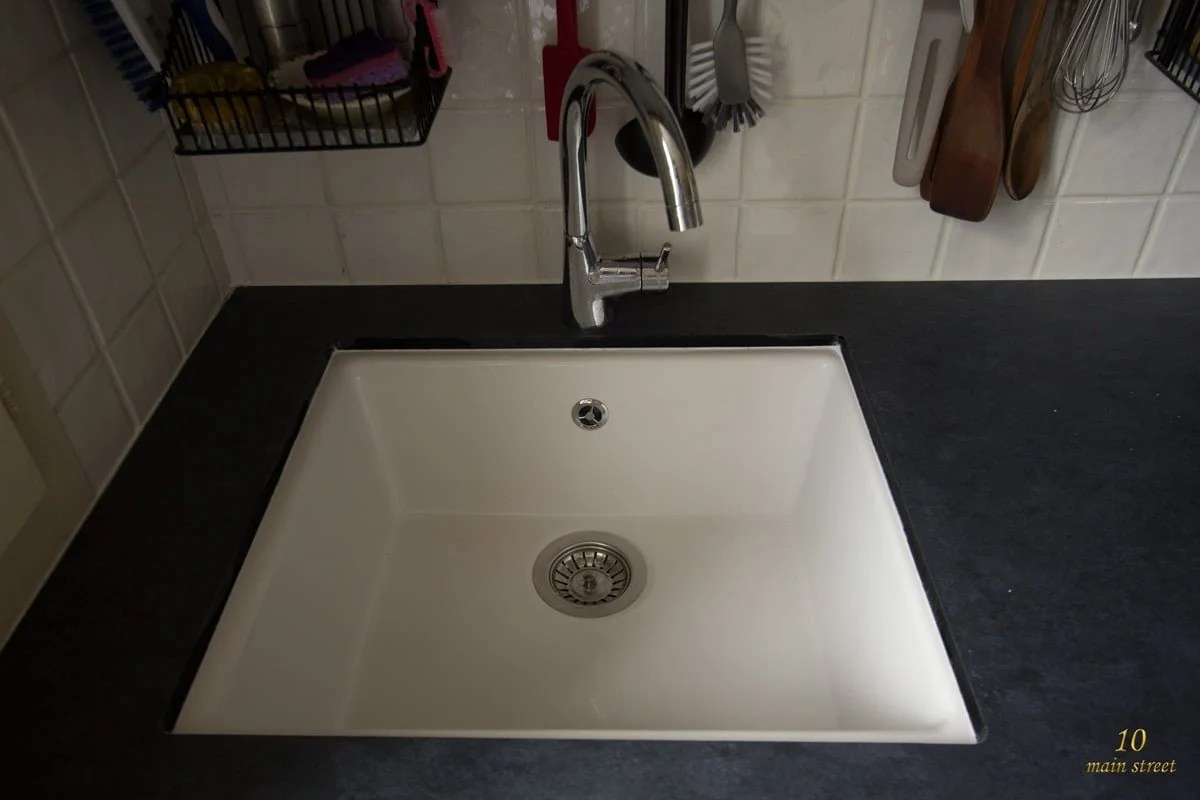 Undermount single bowl ikea domsj sink for a vintage kitchen ikea then we installed a new countertop on top of it all with a nice amount a caulk to secure the whole project it is a dark compact laminate counter workwithnaturefo
