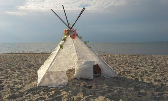 lovely lace teepee for a beach wedding
