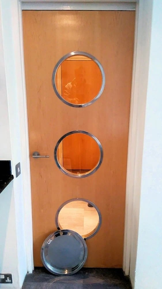 I just glued the trays to the door with silicone but you can also use screws or even straight through bolts for a more nautical look. & Portholes from IKEA Groggy trays - IKEA Hackers