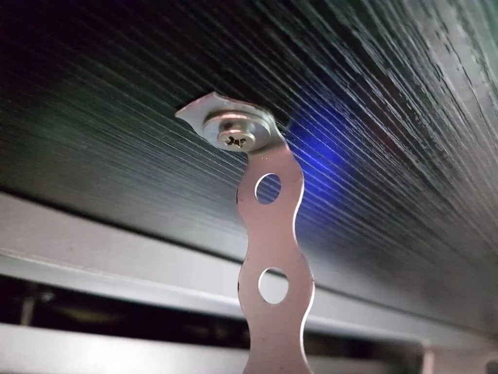 Secure underdesk laptop shelf mount with screws and washers
