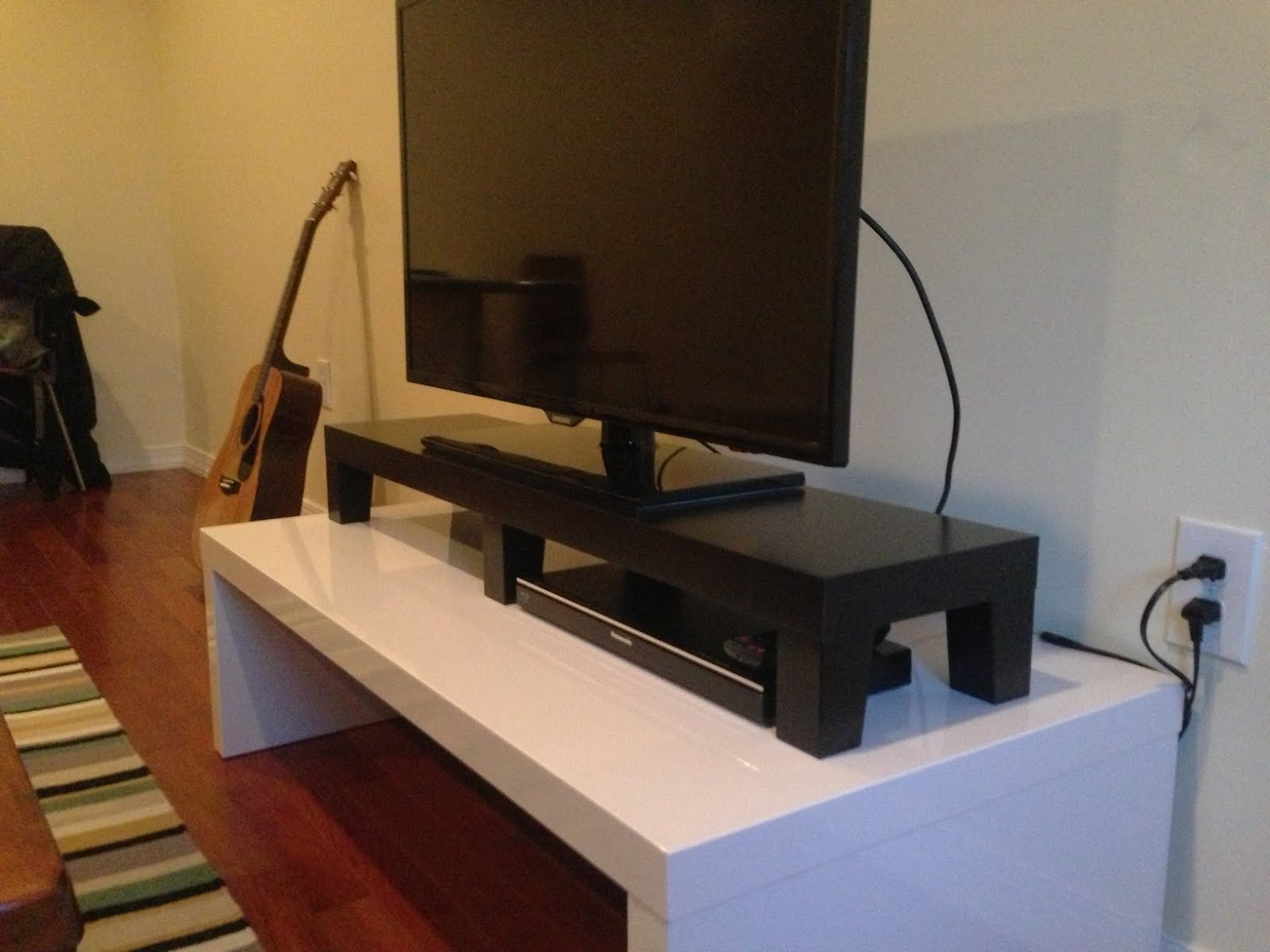 Lack tv riser ikea hackers for Wooden tv stands ikea