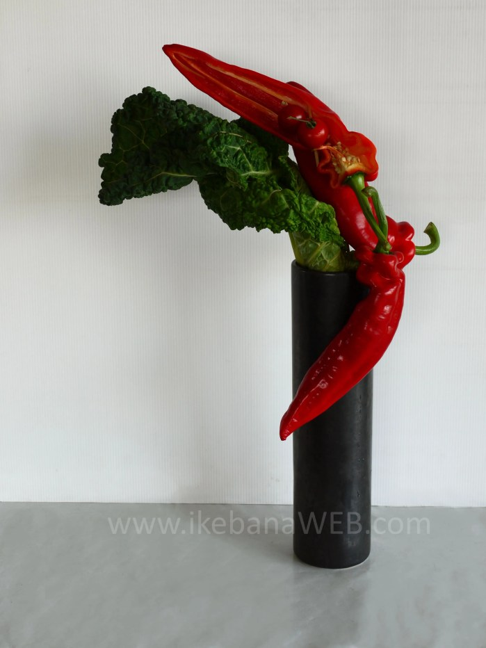 Morimono ikebana arrangement red peppers, green cabbage, color contrasts. By Ekaterina Seehaus. Sogetsu school of ikebana
