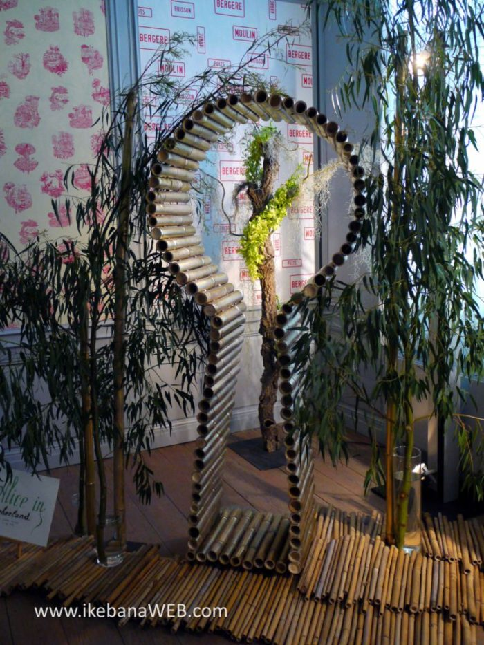 Alice in Wonderland ikebana installation by Ekaterina Seehaus at Fleurs  Des Dames 2017 bamboo, eucalyptus branches, orchids, airplant castel d'ursel
