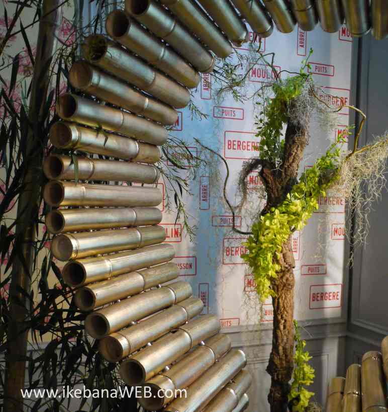 Alice in Wonderland ikebana installation by Ekaterina Seehaus at Fleurs Des Dammes 2017 bamboo, eucalyptus branches, orchids, airplant Castel d'Ursel