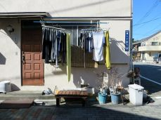 Clothes hanging out to dry down the suburban backstreets