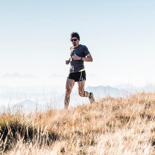 trail runner in meadow