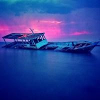 Sunken Boat At Sunset