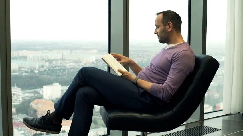 Young Man Reading Book In The City Stock Footage Video