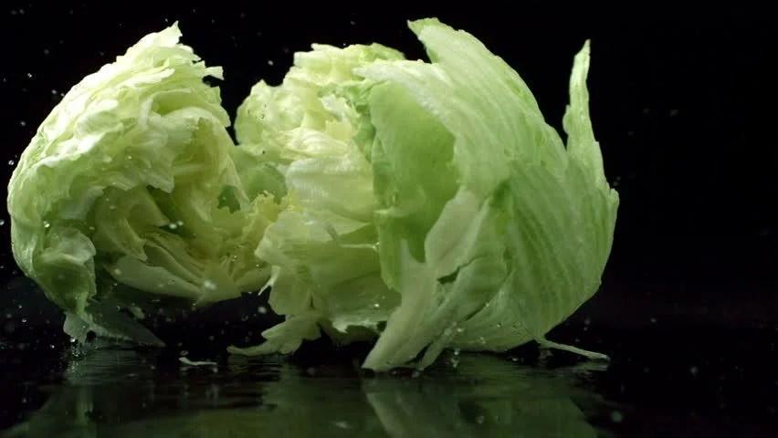 Head Of Lettuce Splashing Onto Black Reflective Surface, Slow Motion Stock Footage Video 4696232 - Shutterstock