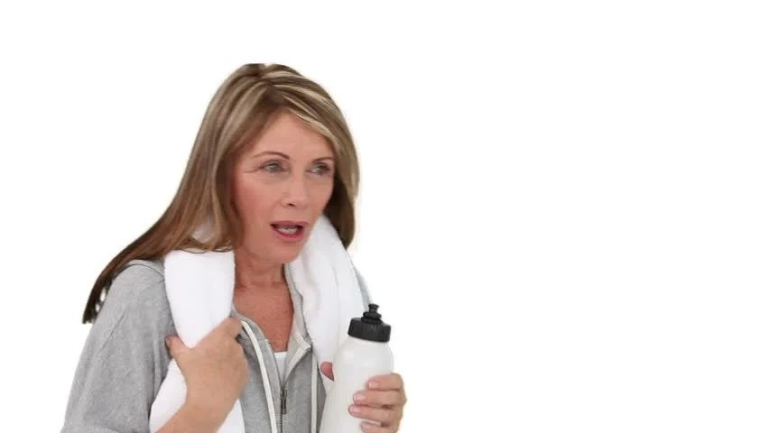 Elderly Woman After Sport Is Out Of Breath And She Is Drinking Water Stock Footage Video 1075588 - Shutterstock