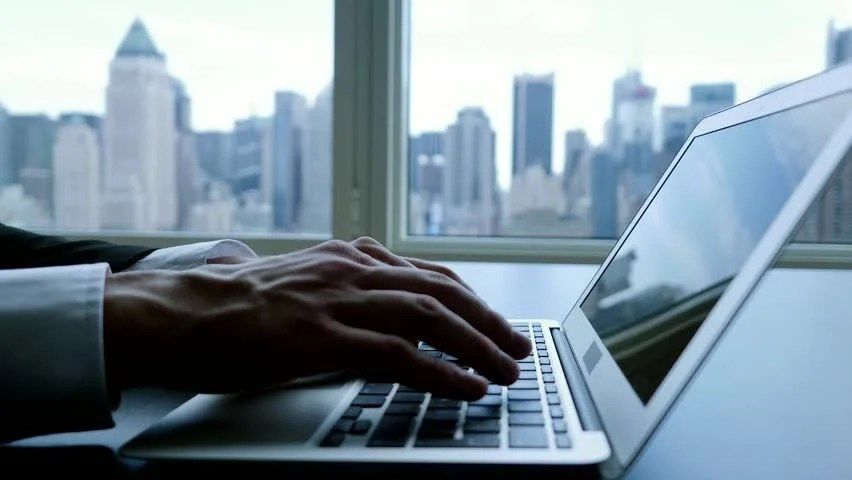 Businessman Working On Laptop In Modern Office Urban City