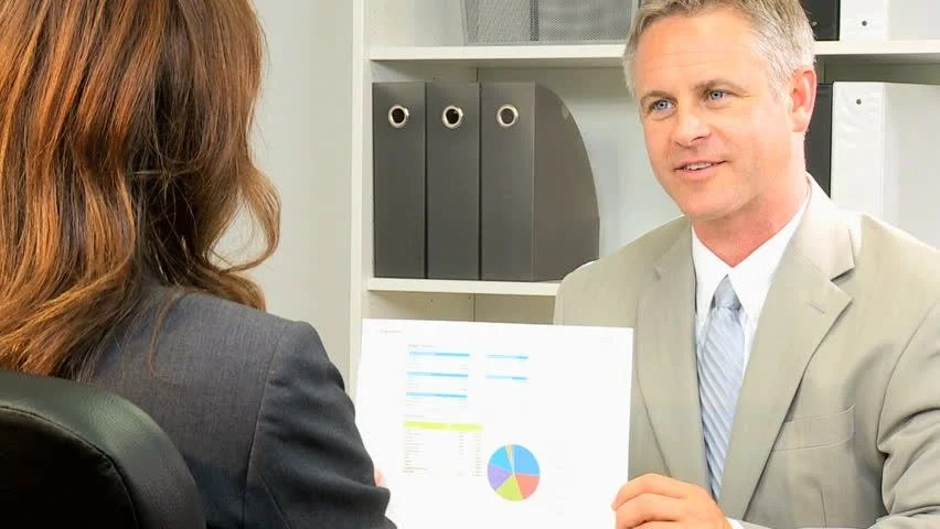 Female Pharmaceutical Saleswoman Meeting Male Doctor In