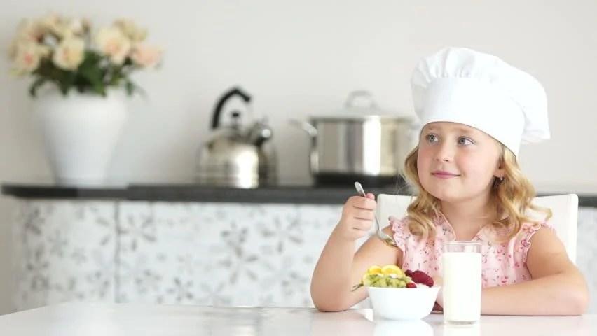 Girl Eatting Yogurt And Drinking Milk Stock Footage Video ...