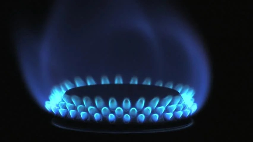 Switching On Gas And Placing Stainless Steel Pot On Gas
