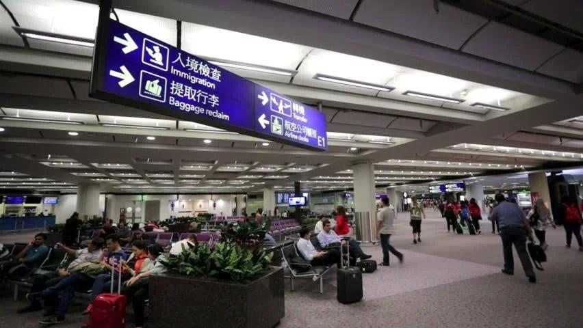 HONG KONG - DECEMBER 2: People At Arrivals And Departures Info Screens At Hong Kong International Airport. Terminal 1 On December 2. 2013 In Hong ...