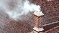 Smoking Brick Chimney. A Domestic Brick Chimney With Black ...