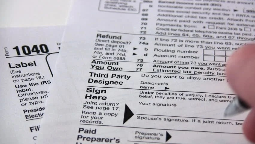 Signing A 1040 Income Tax Return Form. Stock Footage Video