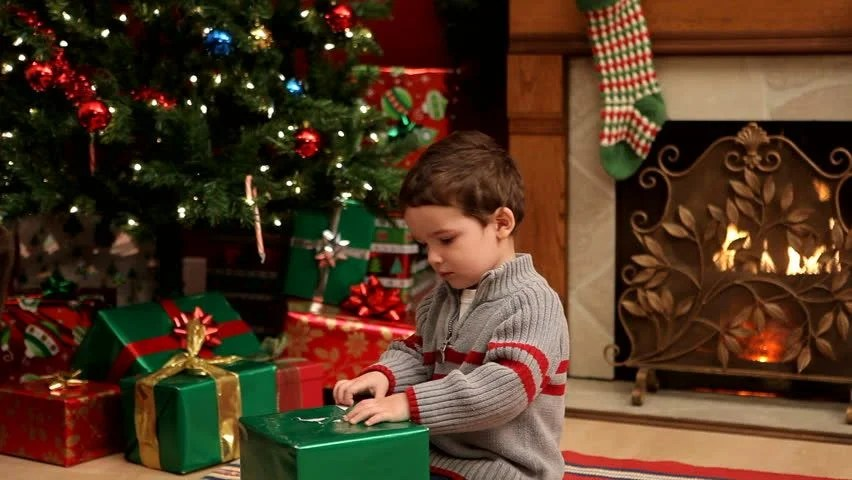 Image result for image of a boy's wrapped christmas present