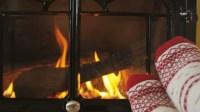 Feet In Warm Socks In Front Of Fireplace In Winter. Woman ...