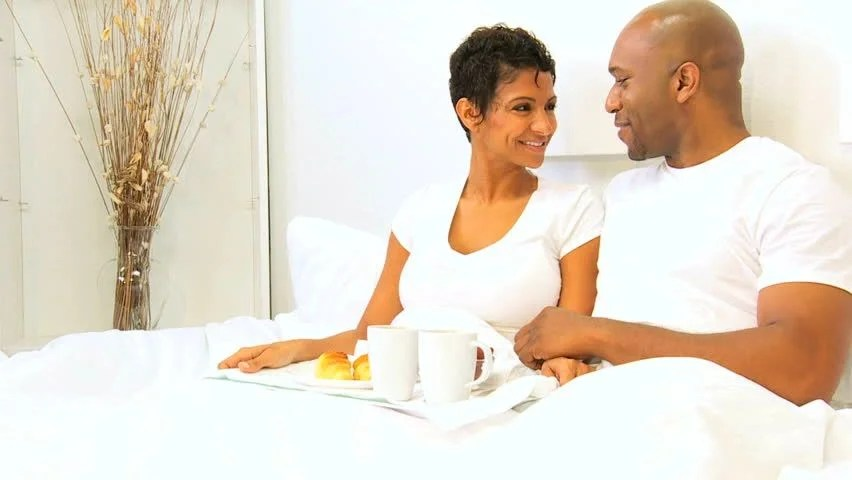 Couple Relaxing In Front Of Fireplace Man Looking At Woman Stock African American Couple Relaxing Sharing Breakfast Bed