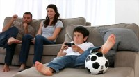 Parents Watching Their Children Play Video Games At Home ...