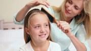 mother brushing daughters hair