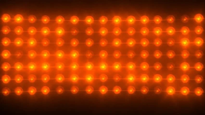 Bright Floodlights Flashing And Forming Figures Orange