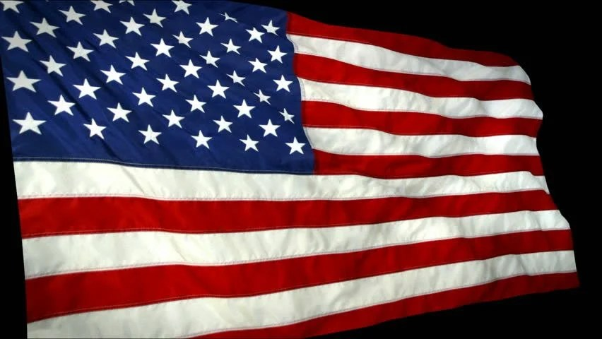 Close Up Of Large US Flag Flying Stock Footage Video
