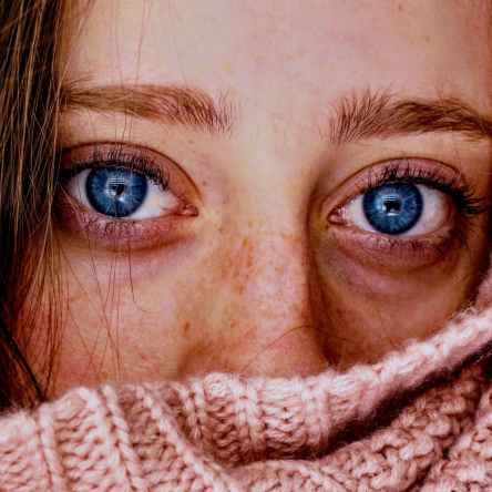 Woman with PMS blue eyes