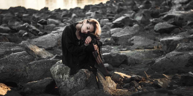 Woman stress rocks black dress