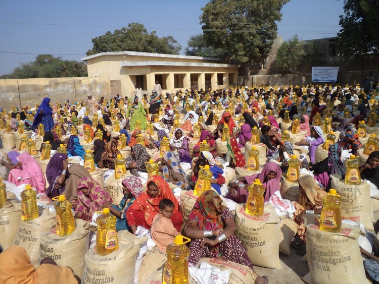 Distribution of Food Packages in Tando Muhammad Khan Sindh 2011