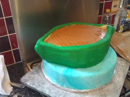 Pea green sugar paste applied