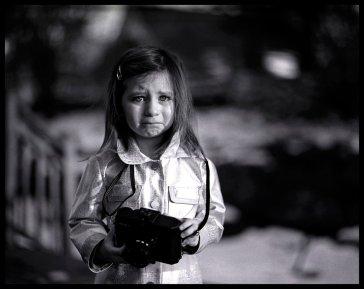 Black and white photo of sad girl shot on ilford HP5+ film