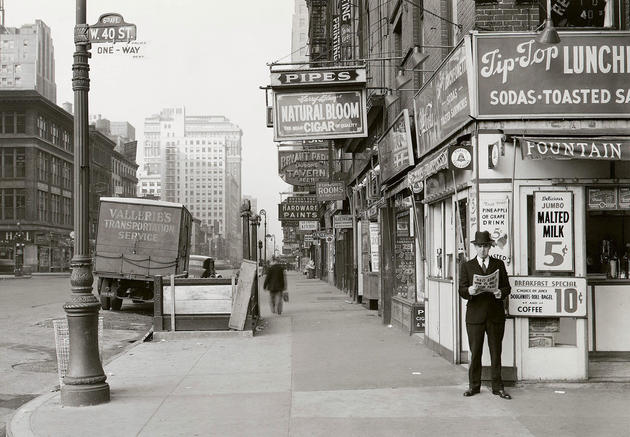 New York man reads the paper in 1940