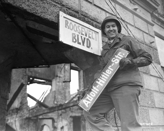 US Soldier takes off hitler Str sign
