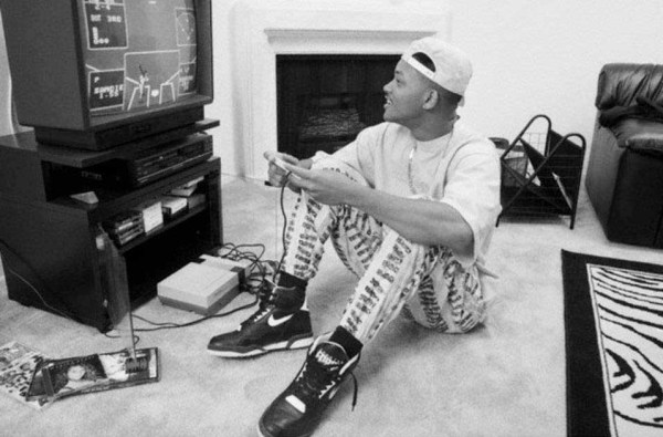 A-young-Will-Smith-playing-a-baseball-game-on-his-Nintendo