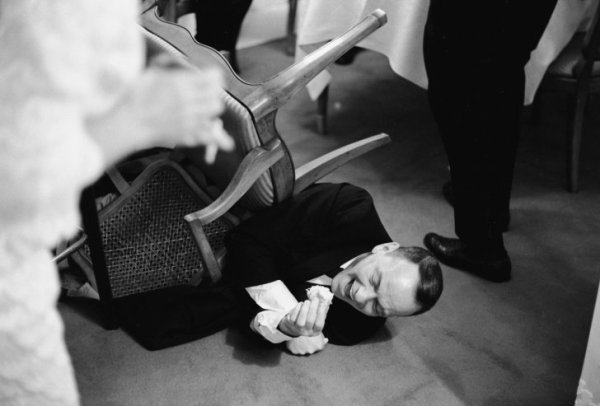 Frank-Sinatra-falling-off-his-chair-laughing-at-a-joke-told-by-Joe-E.-Lewis