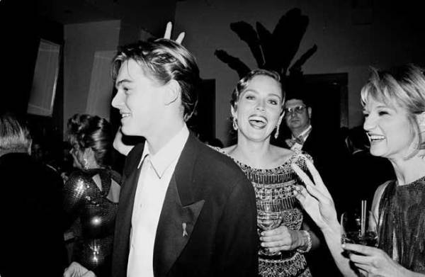 Sharon-Stone-and-Ellen-Barkin-teasing-a-19-year-old-Leonardo-DiCaprio-at-Vanity-Fair's-first-annual-Oscar-party