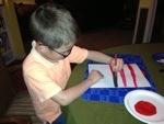 Then we painted red stripes on white paper hats (cuz Mom was out of red construction paper!).