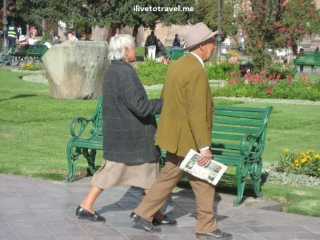 Local couple taking a stroll in the main plaza of Cusco (Cuzco), Peru