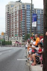 Spectators for Atlanta's Peachtree Road Race lining up Peachtree Street