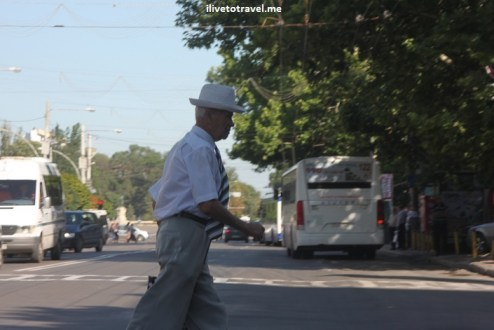 Man crossing street in Chisinau, Moldova