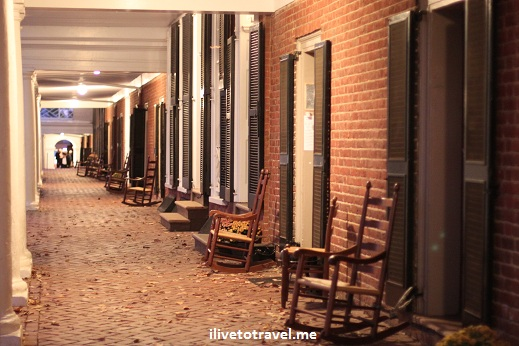 Open hallway to the courtyard at University of Virginia with rocking chairs