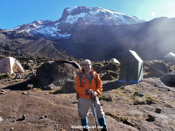 Hiker, Trekker in front of Mt. Kilimanjaro, Tanzania wearing Arcteryx