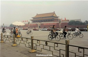 Entrance to the Forbidden City Beijing, China bicycles cars pollution